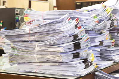 stacks of paperwork for freight audit & pay